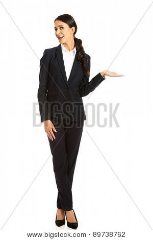 Businesswoman holding copyspace on the left hand.