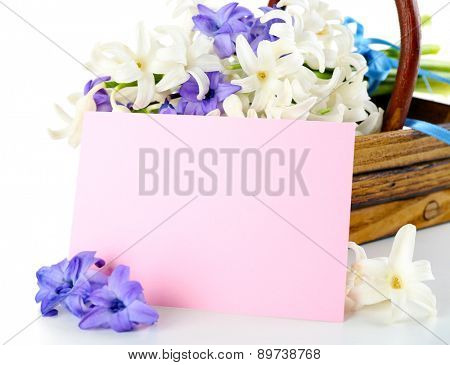 Beautiful hydrangea in wooden basket with card close up