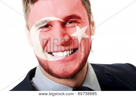 Happy man with Turkey flag painted on face.