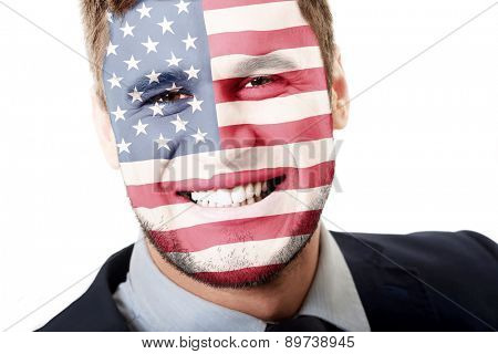 Happy man with USA flag painted on face.