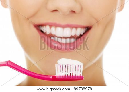 Happy woman with a toothbrush.