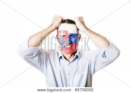 Mature man with Slovakia flag painted on face.