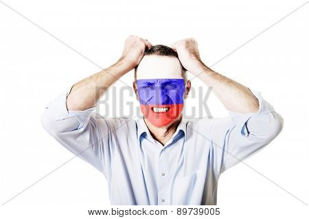 Mature man with Russia flag painted on face.
