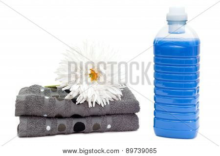 Laundry Detergent With Towels And Flower
