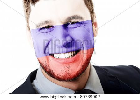 Happy man with Russia flag painted on face.