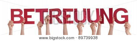 People Holding Straight Word Betreuung Means Care