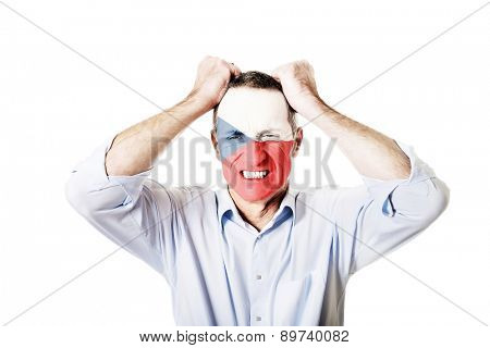 Mature man with Czech Republic flag painted on face.