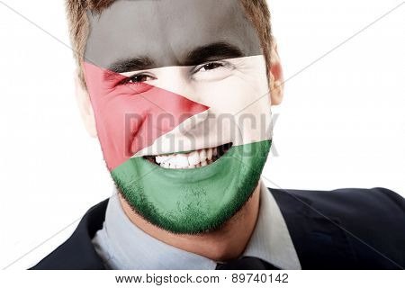 Happy man with Palestine flag painted on face.