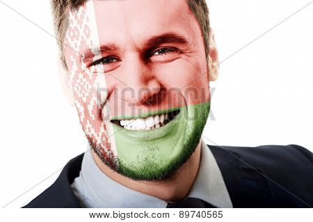 Happy man with Belarus flag painted on face.