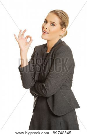 Young businesswoman showing perfect sign