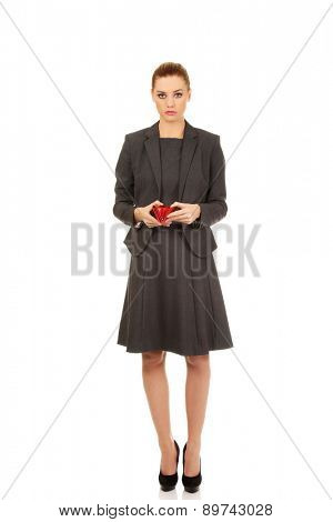 Unhappy businesswoman with empty wallet.