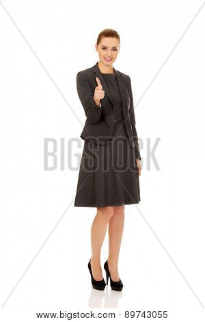 Beautiful businesswoman pointing on camera.