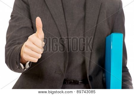 Business woman with binder showing thumbs up.