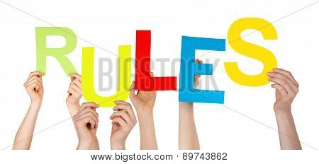 Many People Hands Holding Colorful Word Rules