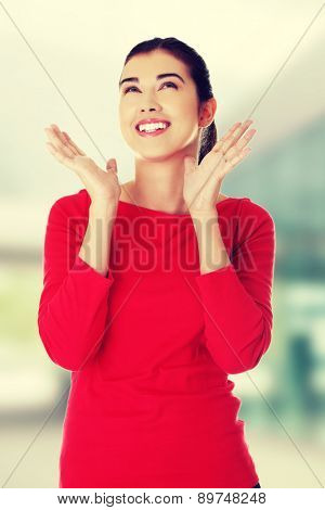Cheerful woman posing in red shirt