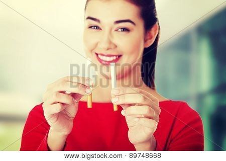 Young woman with two cigarettes