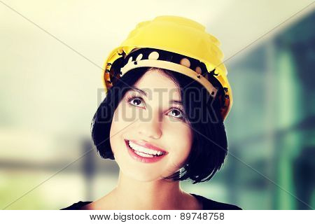 Happy woman wearing a helmet