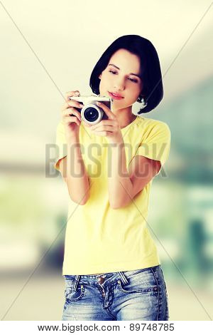 Happy woman holding a camera