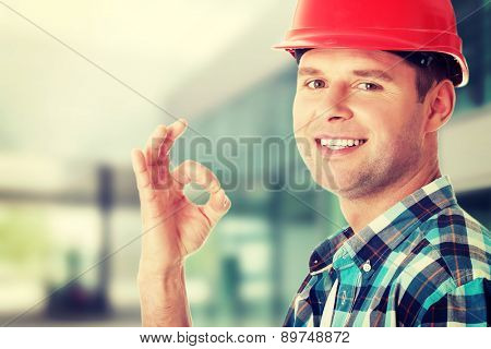 Happy handsome engineer gesturing OK