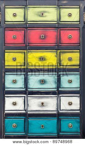 Cupboard with multicolored drawers