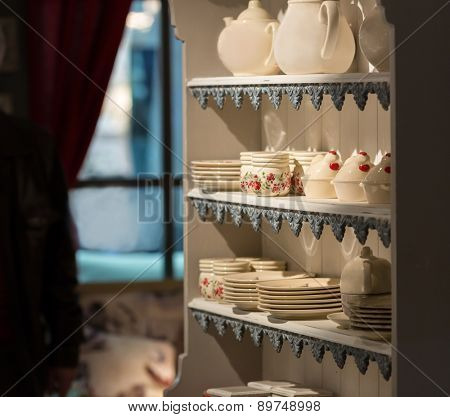 Set of dishes on the shelf