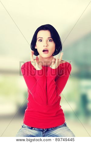 Stressed and shocked woman is going crazy in frustration.