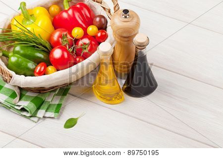 Fresh vegetables and condiments on wooden table
