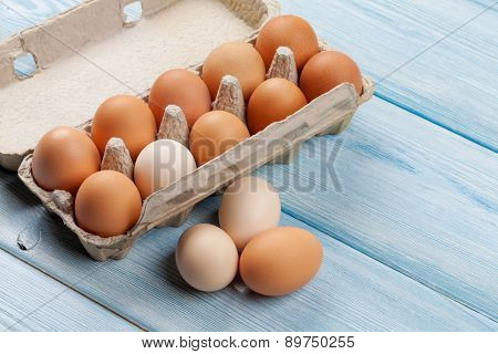 Cardboard egg box on blue wooden table