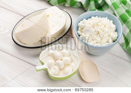 Dairy products on wooden table. Milk cheese and curd