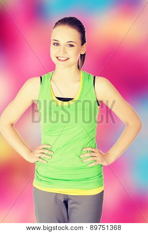 Fitness woman standing and smiling