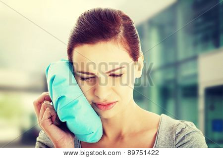 Young beautiful woman having toothache