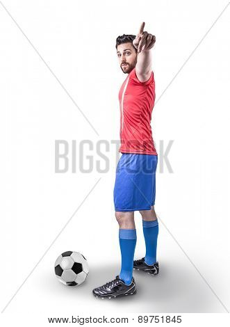 Soccer player on red and blue uniform on white background