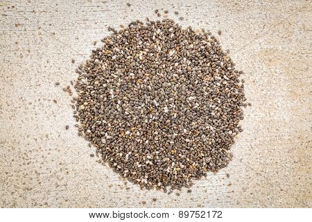 top view of chia seeds pile against rustic white painted barn wood