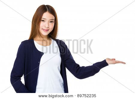 Asian woman with hand showing blank space