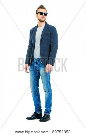 Full length portrait of casual young man wearing jeans and jacket. Men's beauty, fashion. Isolated over white.