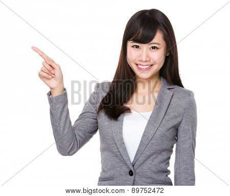 Businesswoman with finger pointing up