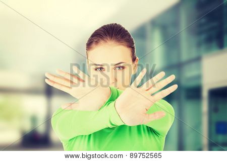 Young woman making stop sign