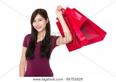 Young woman holding with shopping bag