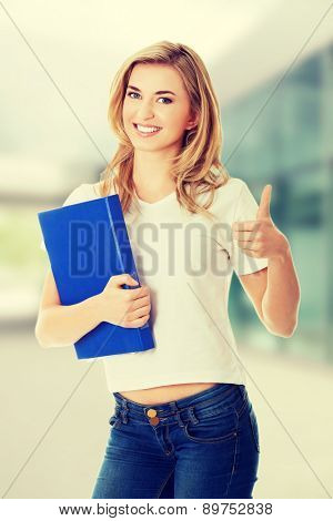 Happy with ok hand sign holding a note