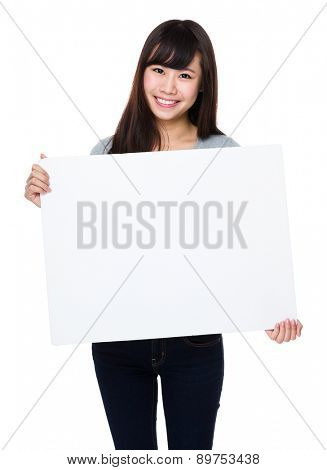 Asian woman show with white poster