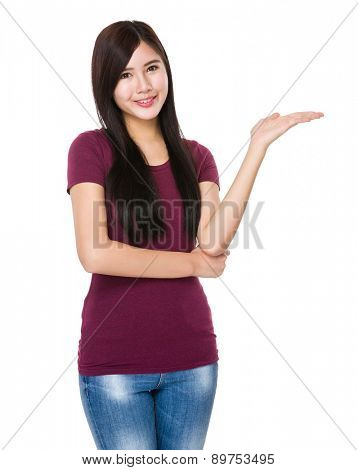 Young woman with hand showing something