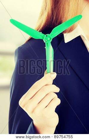 Beautiful caucasian business woman with green propeller
