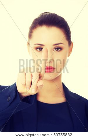 Young businesswoman pointing by a finger