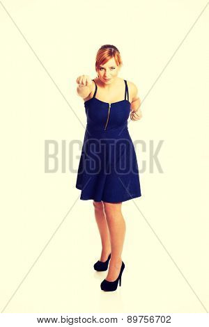 Overweight angry woman with her fists up