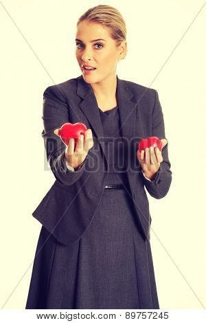 Businesswoman holding small heart model