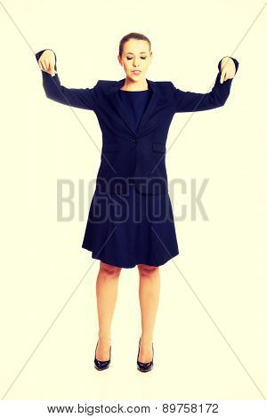 Pretty businesswoman pointing on something