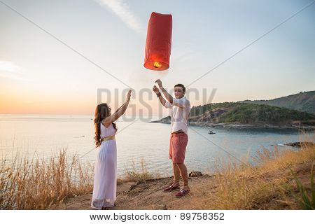 Romantic Couple Holding Fire Lanter