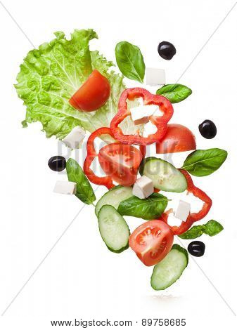 salad isolated in white with clipping path - red tomatoes, pepper, cheese, basil, cucumber and olives, top view
