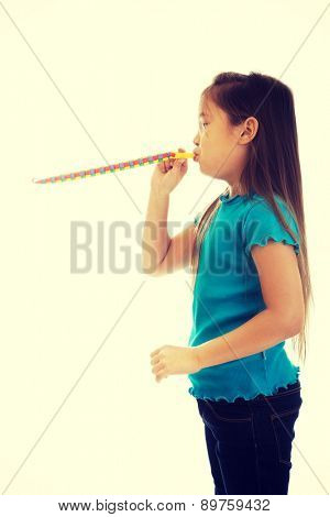 Cute little girl blowing ribbon