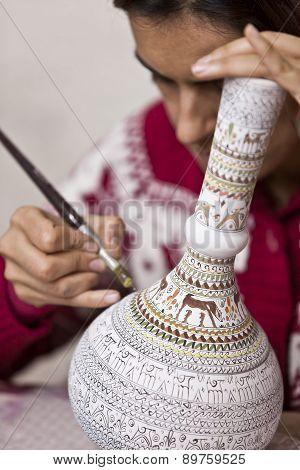 Turkish Woman Adding Detail To Vase